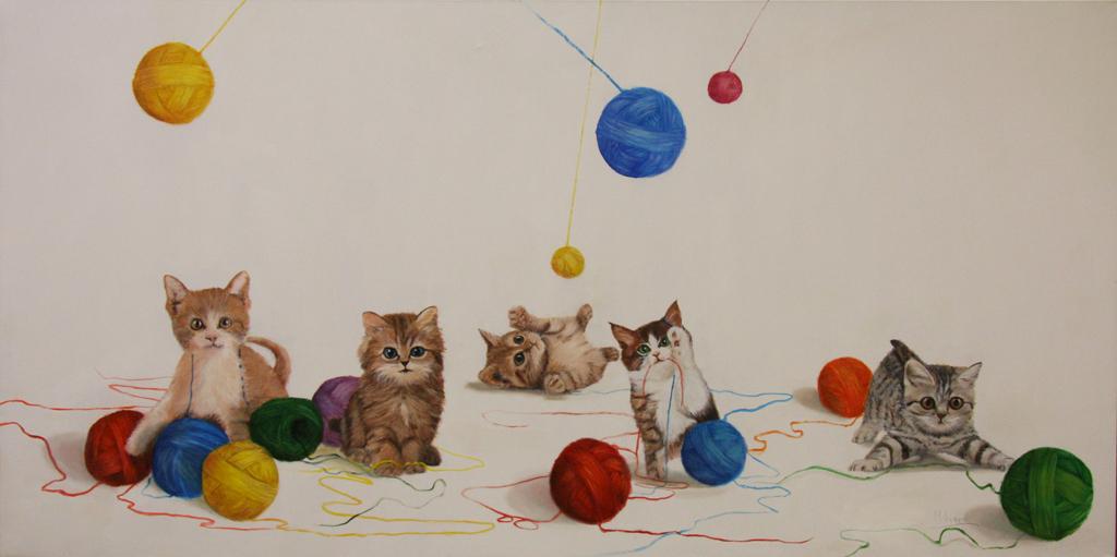 Gatos y ovillos